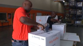Relief Group Giving Care Packets to Tornado Victims