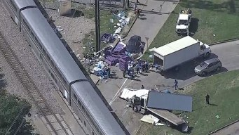 Amtrak Train Hits Truck Crossing Tracks in Dallas