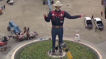 Big Tex Hoisted Into Place