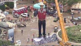Crews Lift Big Tex Into Place at Fair Park for Fair