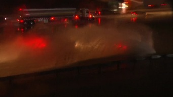 Raw: Cars Plow Through Flooded Highway Exit
