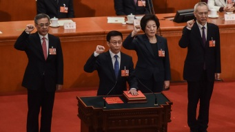 China Appeals for Cooperation as It Warns of 'Trade War'