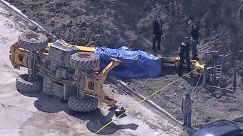 Large Forklift Overturns, Killing Driver