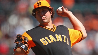Holland, 3 Relievers Pitch Giants Past Rangers