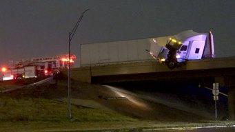 Raw: Big Rig Hangs Off Interstate in Farmers Branch