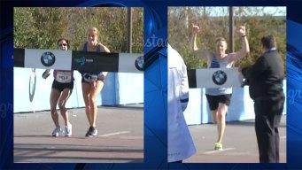Dallas Marathon Women's Division Winner Helped Across Finish