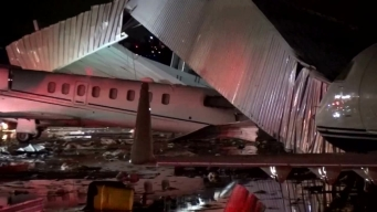 Raw Video: Intense Winds Damage Airplane Hangar