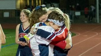 Player Celebrates Football Championship With Big Hug for Mom