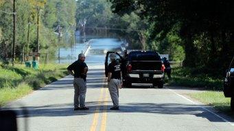 2 Women Drown as Van Swept Into Floodwaters