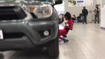 Going Viral: Woman Limbos Underneath SUV