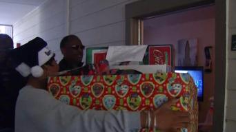 DPD Chief, Officers Make Special Delivery to Victim's Family