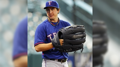 Rangers' Holland Pitches 3 Scoreless in Spring Debut