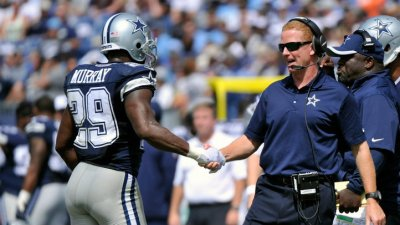Cowboys Run Over Titans, 26-10