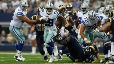 Cowboys Whip Rams, 31-7