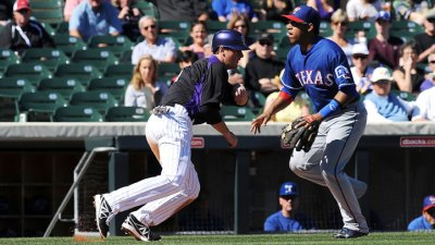 Rockies Beat Rangers 9-1