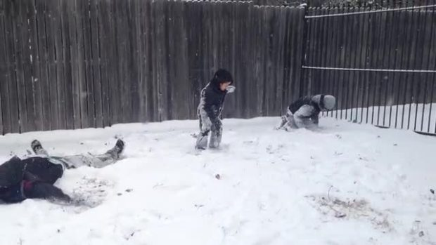 Muñoz brothers enjoying the snow