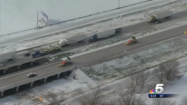 [DFW] Road Crews Work Feverishly To Clear Ice From I-35