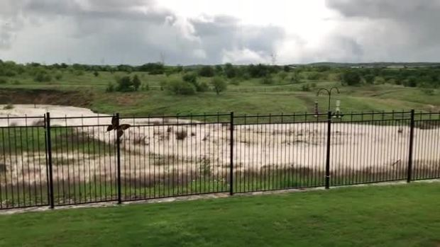 Flooding in South Denton county this ditch behind our house normally has no water in it