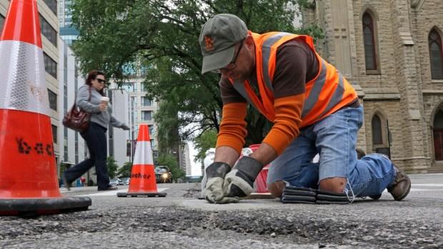 Chicago Man Fills Potholes With Art