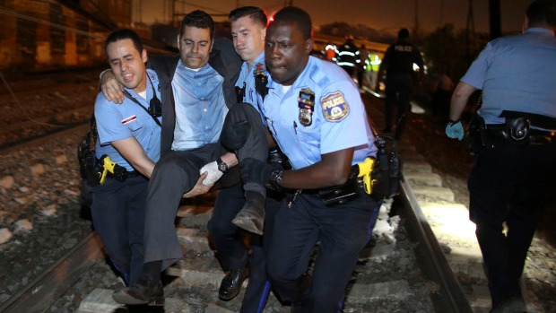 [NATL] Dramatic Images: Amtrak Train Derails in Philadelphia