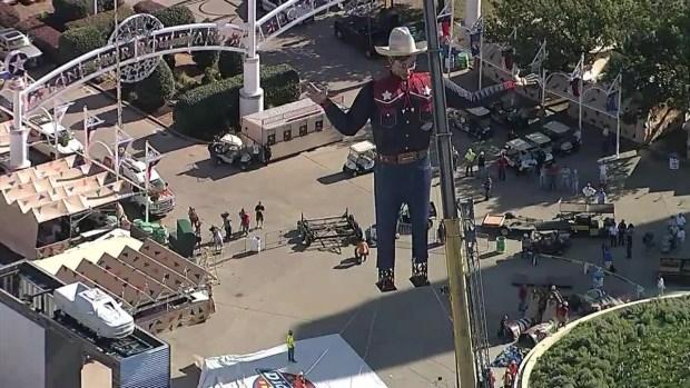 Raw Video: Big Tex Raised Into Place