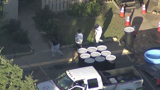 Family Leaves Apartment as Teams Decontaminates Home