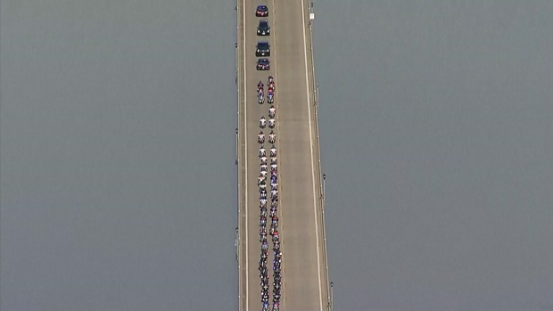Procession Leads From Arlington to Dallas for GP Officer