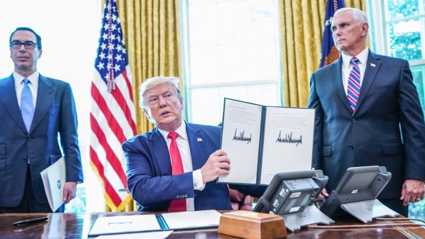Top News Photos: President Trump Signs Iran Sanctions