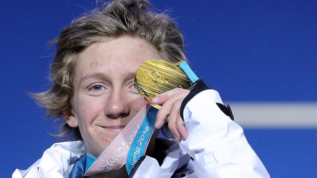 Red Gerard First to Win Medal for US