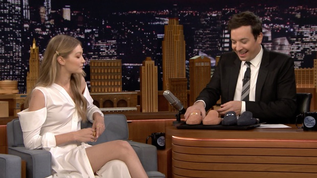 [NATL] 'Tonight': Gigi Hadid Gives Jimmy Fallon the Only Men's Pair of Her EyeLoveMore Mules Shoe