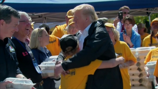 [NATL] Boy Gets Hug From Trump at Florence Aid Event