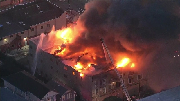 RAW: Firefighters Battle Raging Flames in Oakland
