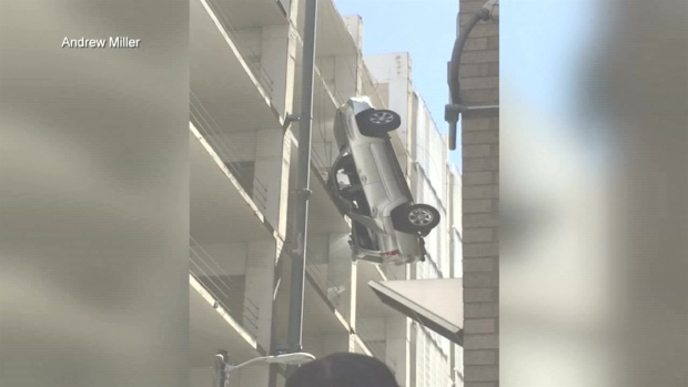 Driver Escapes Car Dangling From an Austin Parking Garage