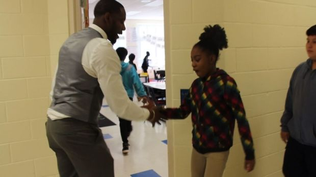 [NATL] Teacher's Twist On A High-Five Helps Engage Students