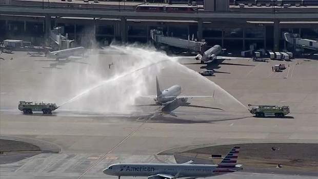 Plane Carrying DallasFirefighter Arrives at D/FW Airport