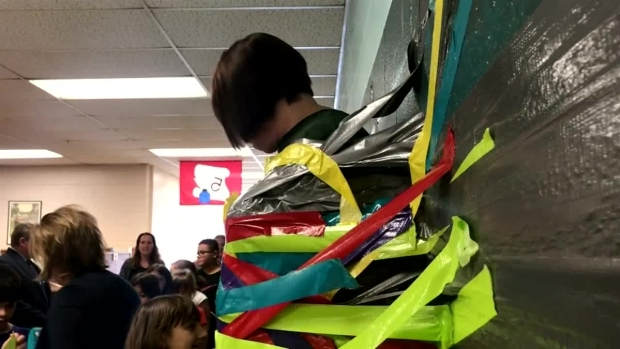 [DFW] Principal Taped to Wall for Good Cause