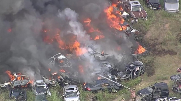 [DFW] Raw Video: Firefighters Battle Massive Salvage Yard Fire