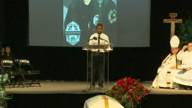 Officer's Godson Reads Bible at Funeral