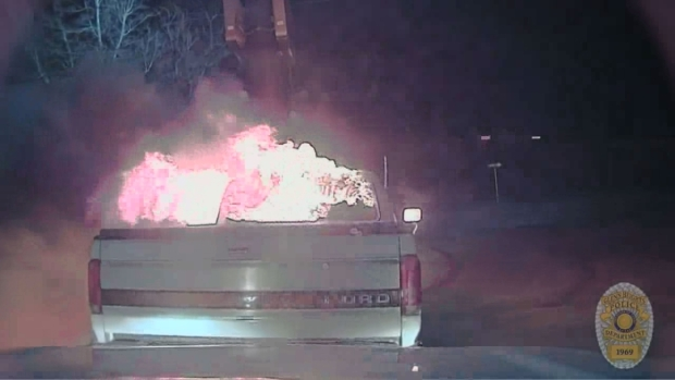 Dash cam captures officer push burning truck away from fast food restaurant