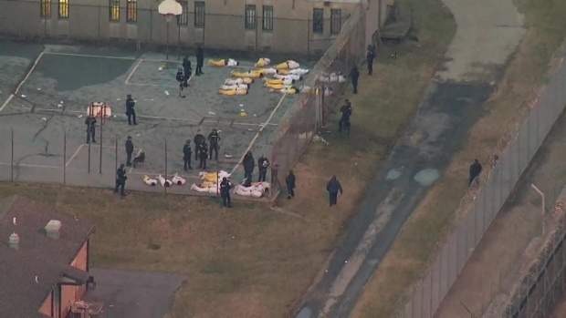 Raw Video: Prisoners Taken Outside After Hostage Standoff