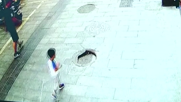[DFW] Video: Boy Falls Into Manhole in China