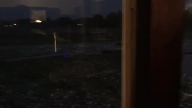 hail banging off glass and covering yard