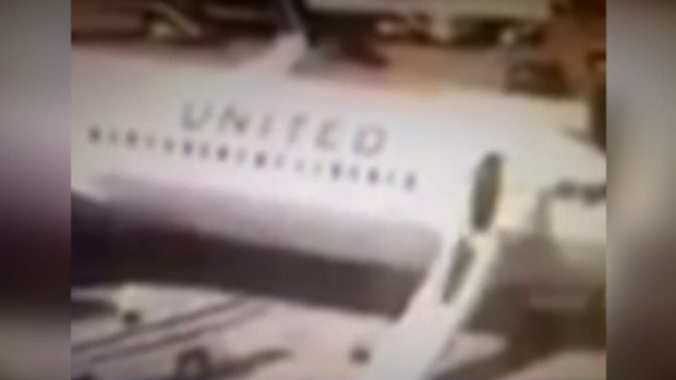 [DFW] United Flight Attendant Deploys Slide After Landing