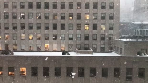 Big Snowflakes Fall Outside Rockefeller Center