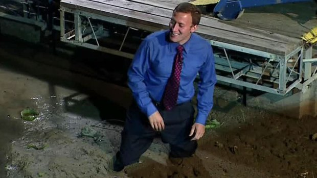 [DFW] Reporter Gets Stuck in Mud, Rescued by Photographer