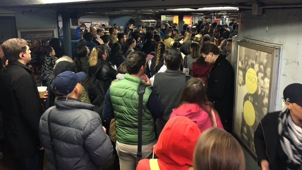 In Photos: Commuter Chaos After Derailment, Flooding