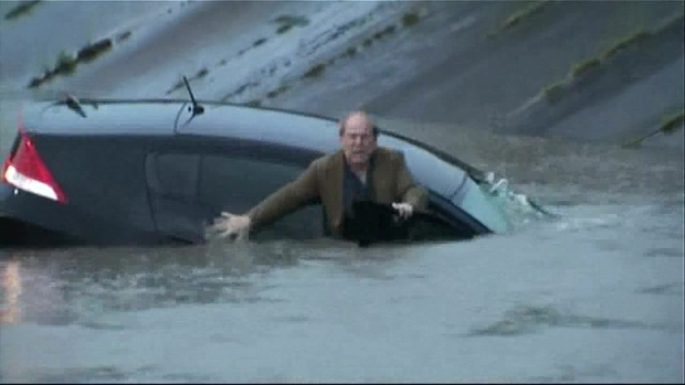 Houston TV Reporter Helps Rescue Man From Flooded Road