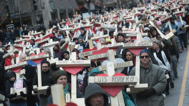 [NATL-CHI] Mournful Procession Carries Crosses For Gun Violence Victims Down Magnificent Mile