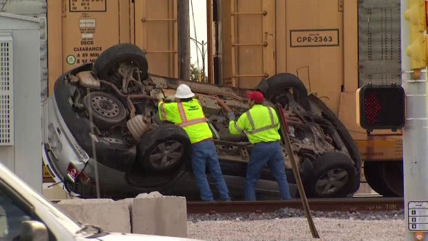 Train, Car Hauler Collide in Arlington