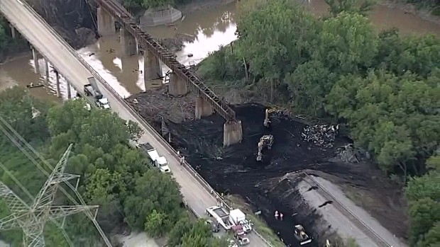 Coal Cleanup After Train Derailment (Raw Video)